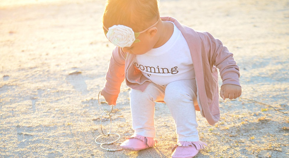 Baby on beach with Kleynimals Jangles